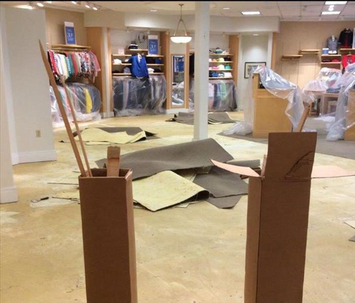 Sewage backup in Monroe Clothing Store Before