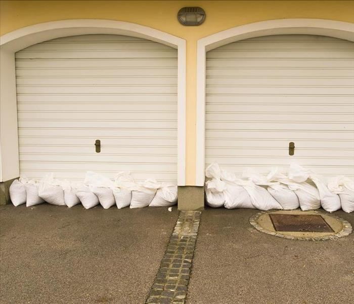 sandbags stacked to prevent flooding at garage doors