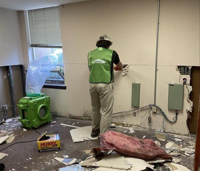servpro worker demolition action