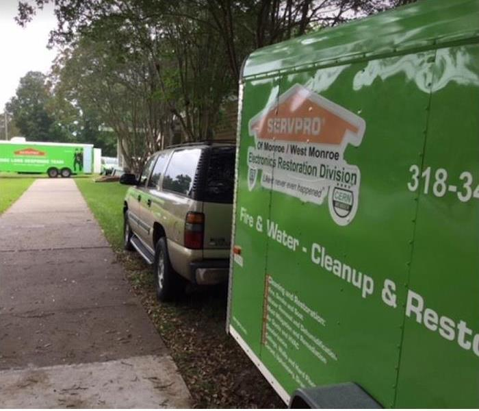SERVPRO vehicles by home